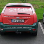 oasis group car wrap
