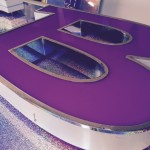 built up letter with purple face